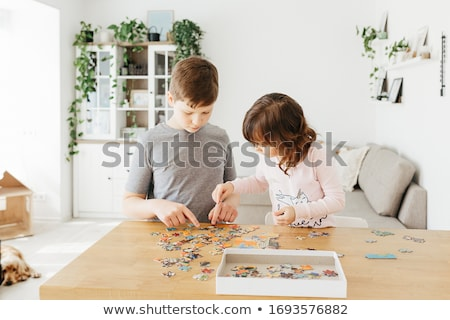 Family completing jigsaw at home Stock photo © photography33
