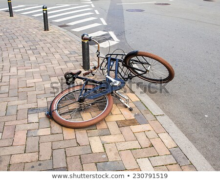 A lone bicycle thrown on the street. Stock photo © maisicon