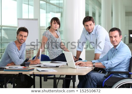 Adam tekerlekli sandalye büro arkadaşları bilgisayar ofis Stok fotoğraf © photography33
