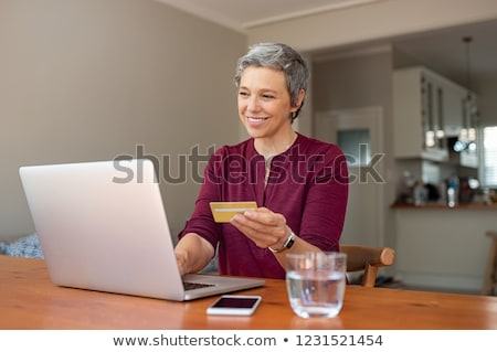 Older woman using a card online Stock photo © photography33