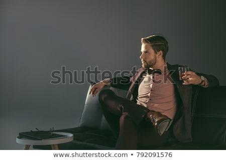 empresario · mirando · vidrio · whisky · cóctel · estilo · de · vida - foto stock © pedromonteiro