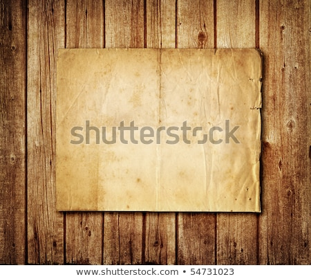 paper with pin on brown wood texture stock photo © gladiolus