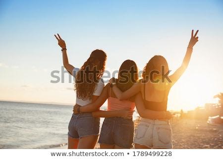 mulher · as · mãos · levantadas · pôr · do · sol · tempo · azul · adolescente - foto stock © andreykr