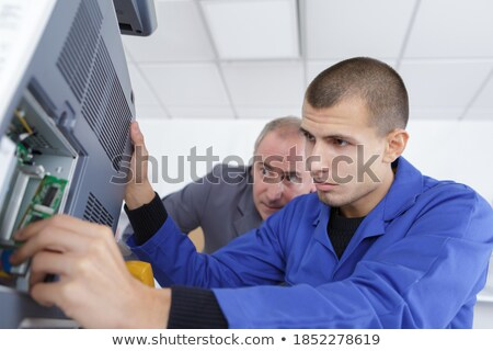 builder with tools of the trade and a laptop computer stock photo © photography33