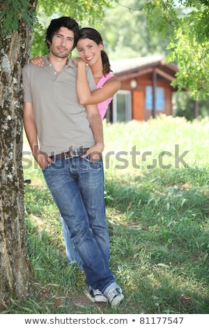 Young couple standing outside a wooden cabin Stock photo © photography33