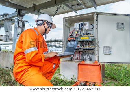 female electrician with laptop and voltmeter stock photo © photography33