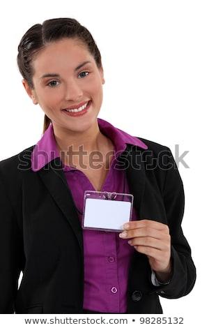 woman displaying visitor badge stock photo © photography33
