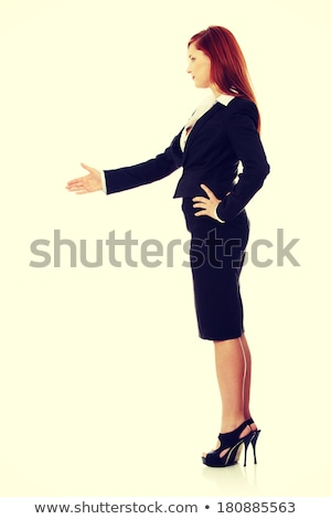 Woman with hand extended to show welcome Stock photo © wavebreak_media