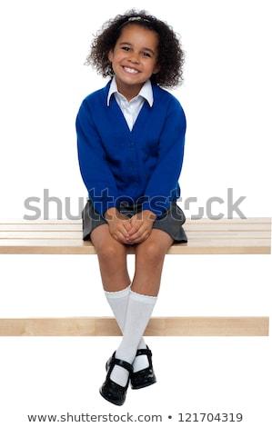 bastante · sentado · banco · las · piernas · cruzadas · nina - foto stock © stockyimages