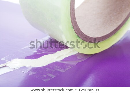 Two pieces of paper join by adhesive tape Stock photo © alexandkz