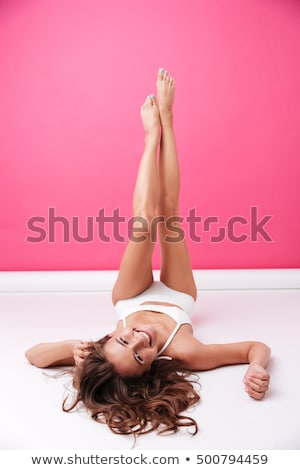 Full length portrait of relaxed cheerful bikini woman stock photo © stockyimages