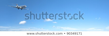 Private jet aircraft in flight. Panoramic composition. Stock photo © moses