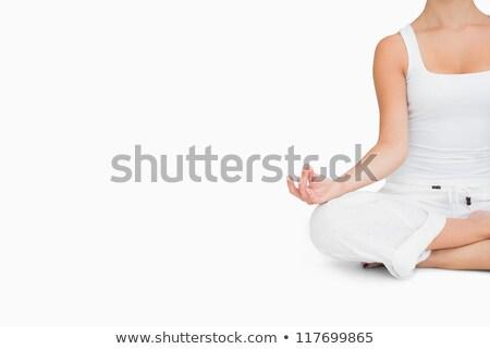Woman doing yoga pose while sitting cross legged Stock photo © wavebreak_media