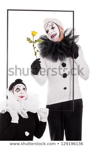 two clowns in a frame with a yellow flower stock photo © Pasiphae