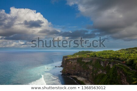 Bali Temple pillar with blue sky in the background. Stock photo © tuulijumala