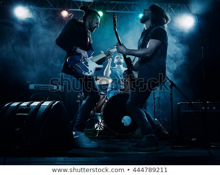 a bassist plays at a live concert Stock photo © stokkete