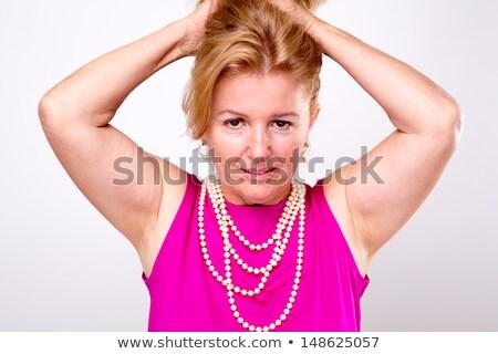 зрелый блондинка Lady оба оружия вверх Сток-фото © ozgur