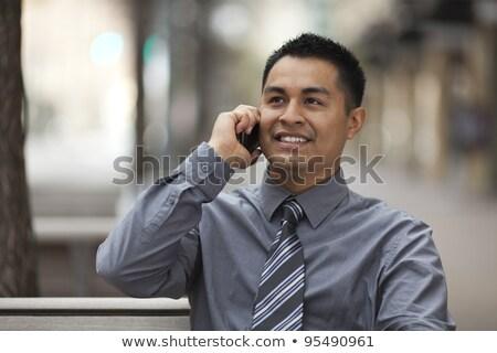 Işadamı oturma bank cep telefonu mutlu Stok fotoğraf © jakubzak