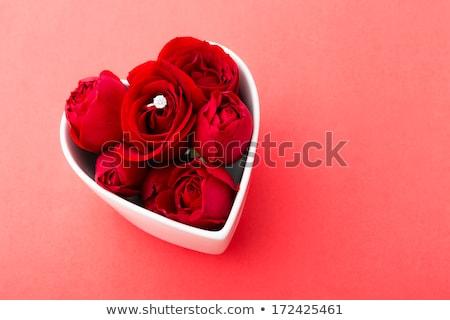 Rose pedal in heart bowl Stock photo © leungchopan