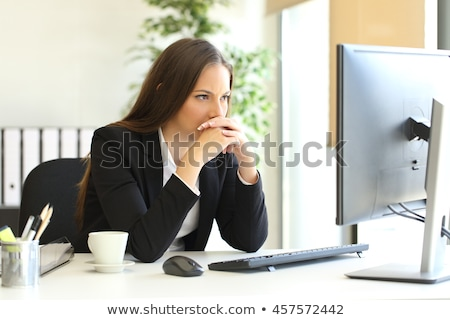 Suspicious businesswoman Stock photo © badmanproduction