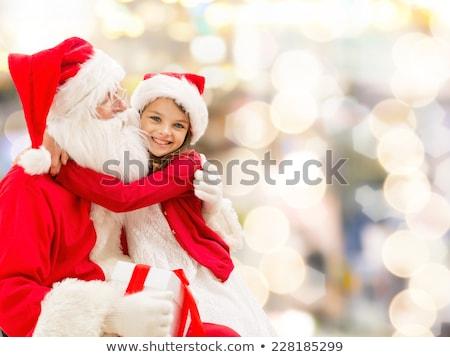 Happy teenage santa clauses stock photo © o_p_m