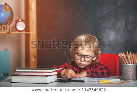 Stockfoto: Schoolboy Sitting On Books Back To School