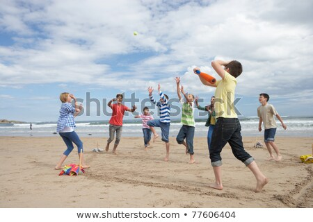 teenagers playing baseball on beach stock photo © monkey_business
