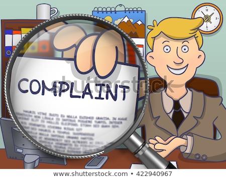 Complaint through Magnifying Glass. Stock photo © tashatuvango