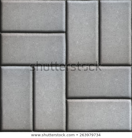 Gray Paving Slabs of Rectangles Laid Out on Two Pieces Perpendicular to Each Other. Stock photo © tashatuvango