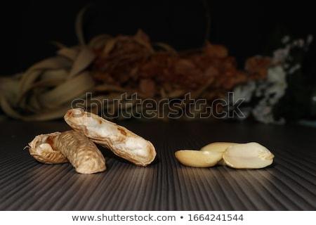 Single peanut with empty shells Stock photo © Ximinez