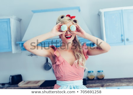 Stock photo: Smiling blonde woman with cupcake.