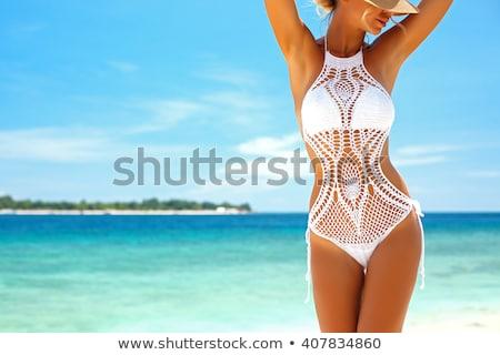 Beautiful model on the beach Stock photo © Anna_Om