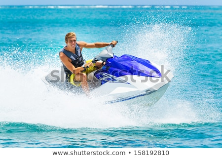 Genç jet ski tropikal okyanus tatil adam Stok fotoğraf © razvanphotos
