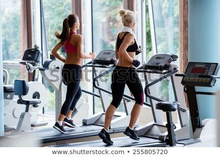 man · roeien · machine · gymnasium · gezondheid - stockfoto © deandrobot