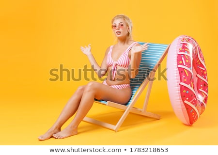 young blonde girl relaxing in a deckchair stock photo © voysla