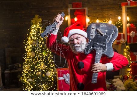 Karácsony mikulás férfi elektromos gitár izolált fehér Stock fotó © Kurhan