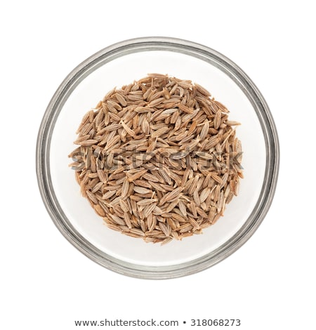 Top view of half filled bowl of Organic Cumin seed. Stock photo © ziprashantzi