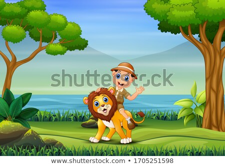 Lion on a tree trunk by a river stock photo © TanArt