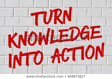 Graffiti on a brick wall - Turn knowledge into action Stock photo © Zerbor