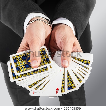 Jeune homme magicien ace carte gris Photo stock © deandrobot