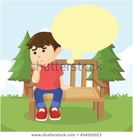 boy sitting on a bench stock photo © meinzahn