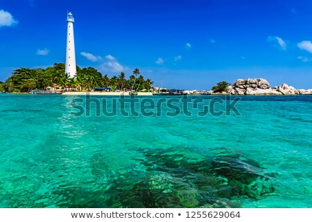Stock photo: Lighthouse and boat at stone island
