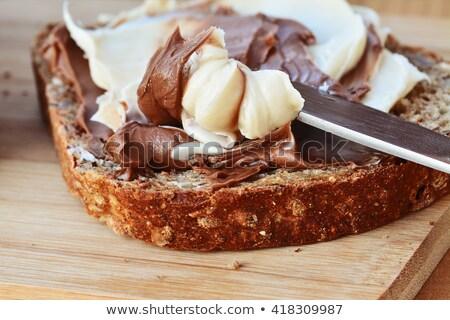 Mogyoró csokoládé krém pirított mogyoró kanál Stock fotó © faustalavagna