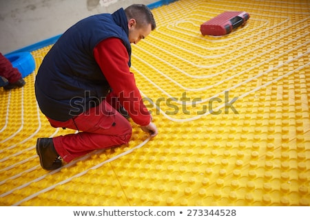 Installing underfloor heating and colling pipes Stock photo © zurijeta