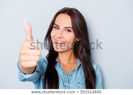 gelukkig · zakenvrouw · tonen · teken · geïsoleerd - stockfoto © deandrobot