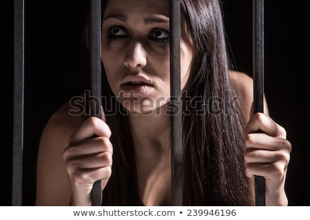 Stock photo: Pretty young woman with cage