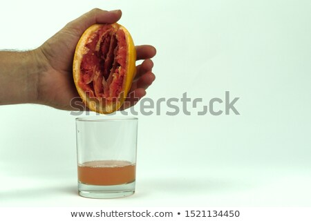 Hands of a man squeezing fresh ruby grapefruit Stock photo © ozgur