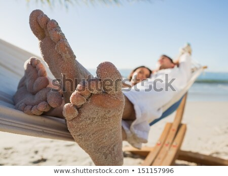 Stock photo: womans sandy feet on beach