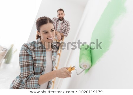 Young woman renovating or decorating her new home Stock photo © dash