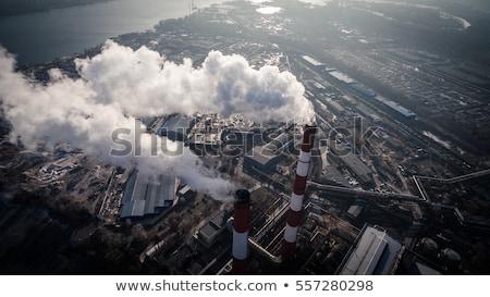 Smoke coming from a chimney Stock photo © Klinker